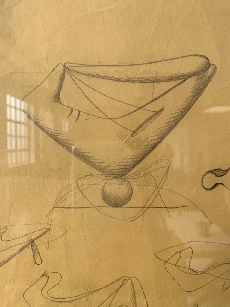 Pencil on aged paper drawings. A smooth strange structure; half human half abstract on top of a ball. (Noguchi)